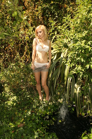 Perfect blonde cutie in booty shorts does slow striptease outdoors - XXXonXXX - Pic 6
