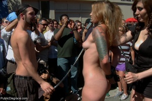 Blonde whore is led around a street fair - XXX Dessert - Picture 3