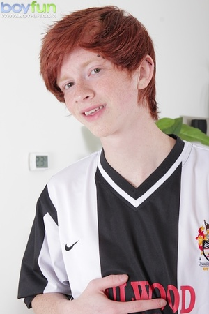 Adorable ginger soccer player with cute tattoos rubs his huge, thick cock - XXXonXXX - Pic 1