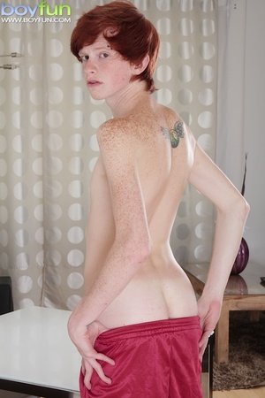 Adorable ginger soccer player with cute tattoos rubs his huge, thick cock - XXXonXXX - Pic 4