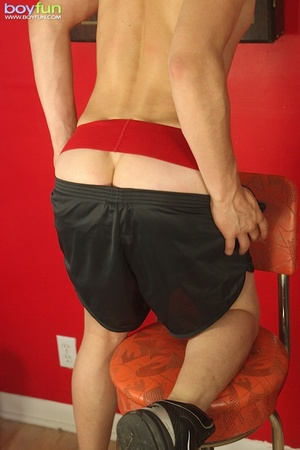 Cute boy wearing a cap and sexy red underwear poses in hot positions - XXXonXXX - Pic 5