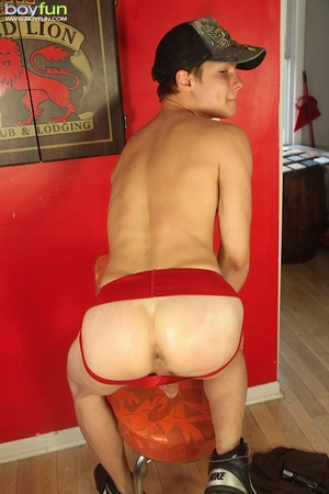 Cute boy wearing a cap and sexy red underwear poses in hot positions - XXXonXXX - Pic 14