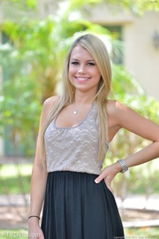 smiling blonde model showing