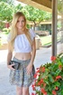 Skinny blonde pulls up her colorful skirt in public