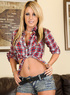 Slutty blonde redneck strips and plays with her pussy on the couch