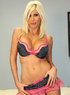 Blonde bombshell in black, pink and white polka dotted underwear takes