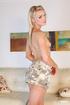 Stunning blonde pose her skinny body before she peels off her black bra