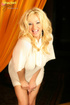 Blonde darling in a white outfit is ready to show…