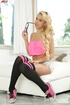 Blonde cutie in pink shows her beautiful body