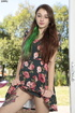 Cute chick peels off her black and pink floral…