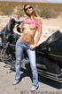 Slim teen wearing jeans poses on the desert and…