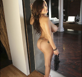 Flirtatious busty babe takes off black panties and flings them at you