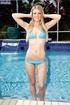 Smoking hot blonde displays her steaming hot body…