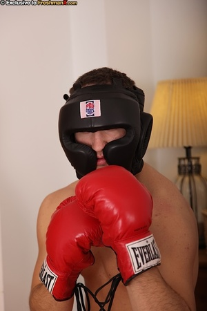 Hunk boxer displays his stunning body wearing his black head gear, red gloves, shorts and white supporter then gets naked and jacks off in his bedroom. - XXXonXXX - Pic 1