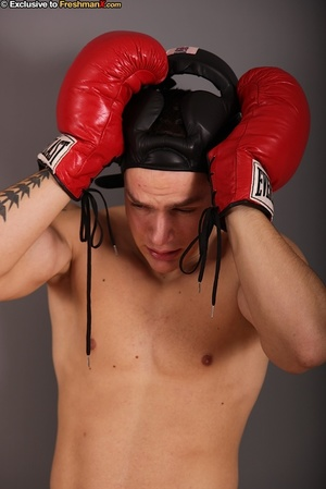 Gorgeous stud with big hard body takes off his black head gear, red and white shorts and black and white supporter then reveals his huge dick while he pose naked wearing his red boxing gloves. - XXXonXXX - Pic 2