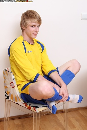 Soccer player in blue and yellow uniform removes his shirt and teases with his hunk body before he pulls down his shorts and wanks his dick in a dining room. - XXXonXXX - Pic 3