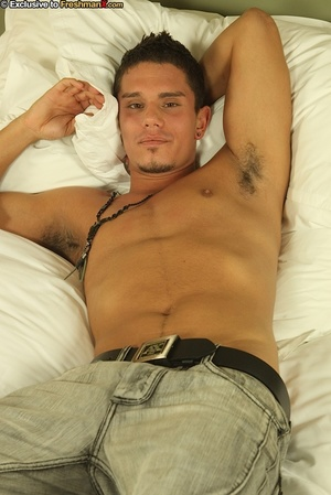 Gorgeous dude takes off his white shirt and reveals his rocky body as he lays topless on a white bed before he strips down his green pants and black brief and reveals his rock hard dick. - XXXonXXX - Pic 4