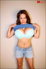 hot brunette poses the