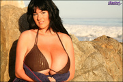 black-haired milf brown-bikini flashes