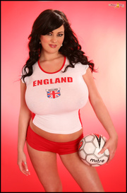 football-loving black-haired babe poses