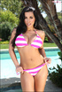 Beautiful brunette in a pink-striped bikini flashes her tits by the pool