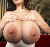 Lady with big areolas shows them off in and out of tshirt