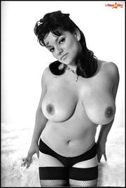 gorgeous dark-haired babe corset