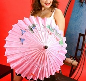 Gorgeous slut with angelical face plays with her pink umbrella flashing
