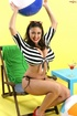 Latina with big boobs enjoys a cocktail while flashing her great curves