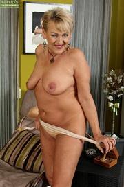 horny granny strips seductively
