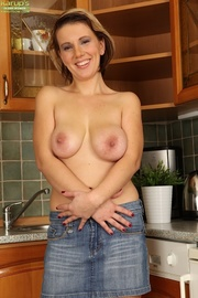 short-haired mature babe bends
