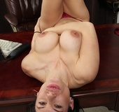 Horny sexytary strips off and lies naked on the desk.