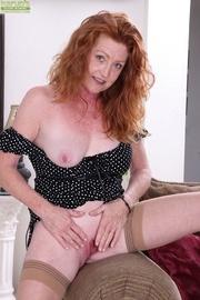 curvy mature redhead strips