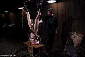 Woman's body is hung upside down and put - XXX Dessert - Picture 17