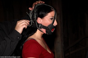 Dark-haired woman withstands involuntary orgasms and caning with her clothing half off. - XXXonXXX - Pic 2