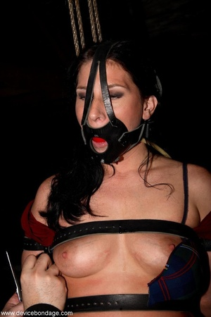 Dark-haired woman withstands involuntary orgasms and caning with her clothing half off. - XXXonXXX - Pic 5