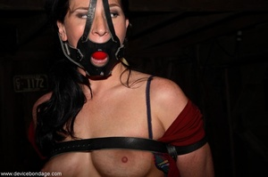 Dark-haired woman withstands involuntary orgasms and caning with her clothing half off. - XXXonXXX - Pic 6