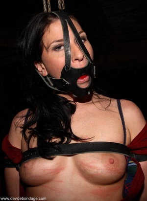 Dark-haired woman withstands involuntary orgasms and caning with her clothing half off. - XXXonXXX - Pic 8