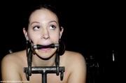 brunette slave looks happy
