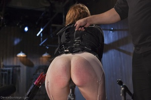 Filly's face is twisted as she endures an unharmonious slave training session. - XXXonXXX - Pic 2