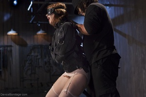 Filly's face is twisted as she endures an unharmonious slave training session. - XXXonXXX - Pic 5