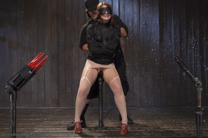 Filly's face is twisted as she endures an unharmonious slave training session. - XXXonXXX - Pic 6