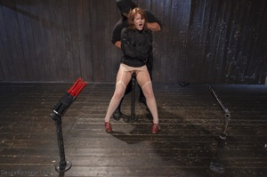 Filly's face is twisted as she endures an unharmonious slave training session. - XXXonXXX - Pic 7