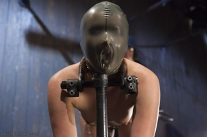 Filly's face is twisted as she endures an unharmonious slave training session. - XXXonXXX - Pic 9