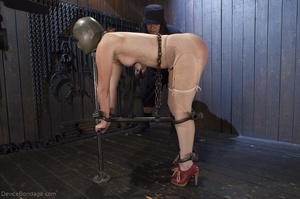 Filly's face is twisted as she endures an unharmonious slave training session. - XXXonXXX - Pic 10
