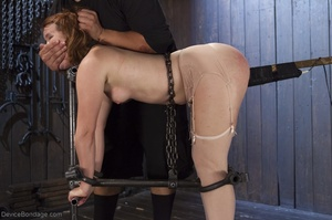 Filly's face is twisted as she endures an unharmonious slave training session. - XXXonXXX - Pic 11