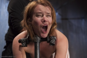 Filly's face is twisted as she endures an unharmonious slave training session. - XXXonXXX - Pic 12