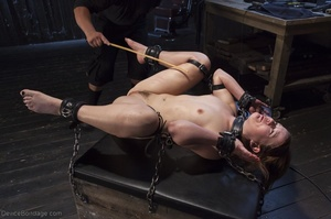 Filly's face is twisted as she endures an unharmonious slave training session. - XXXonXXX - Pic 16