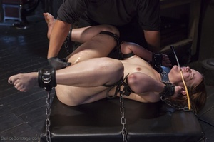 Filly's face is twisted as she endures an unharmonious slave training session. - XXXonXXX - Pic 17