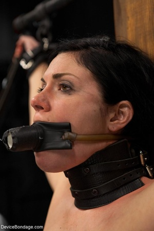 All-natural woman is bound in the most uncomfortable position as she takes the mistreatment well. - XXXonXXX - Pic 7